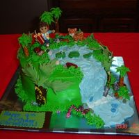 Diego Birthday Cake My version of a diego cake....Iced in buttercream with fondant accents....The Diego is a candle and the lepord is a toy...all the rest in...