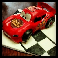 Lightening Mcqueen   3D carved cake...tires are made from Krispy treats. decals from etsy
