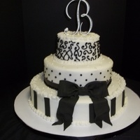 Black And White Affair   14in/10in/6in yellow cake buttercream frosting with fondant accents