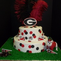 Go Dawgs   10in 6 in chocolate cake with buttercream filling and icing Fondant and gumpaste accents