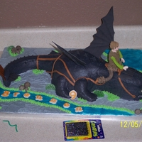 Toothless And Hiccup   All decorations are buttercream and fondant. I modeled Hiccup from a picture I found. This was for a little boys birthday