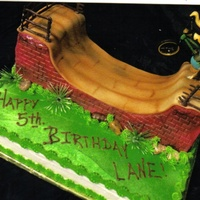 Bike Ramp Cake This was a 9 x 12 sheet cake that I airbrushed green and I made the bike ramp out of rice krispies iced in buttercream and the top of the...