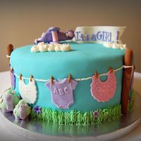 Clothesline Baby Shower Cake Fondant covered cake with gumpaste accents