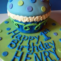 Giant Blue Cupcake   Cupcake made with Wilton Giant Cupcake Pan. Covered in fondant, buttercream accents.