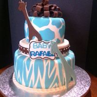 "Blue Giraffe Animal Print Baby Shower Cake 6"" & 10"" pans, the middle is a styrofoam as the client did not want so much cake. MMF, Chocolate fondant for the bow and..."