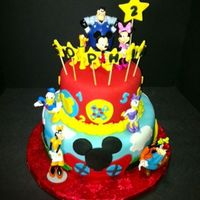"Mickey Mouse Club House Cake 10"" vanilla, 6"" chocolate with MMF and accents. Gum paste stars"