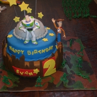 Toy Story 3 Cake  Bottom Tier is red velvet with vanilla cream cheese filling..Middle Tier is white almond cake with rasberry filling. And the moon is a...