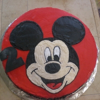 Mickey Mouse   This is a 15 inch round funfetti white cake. Covered in red buttercream.