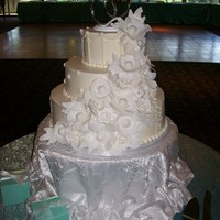 "Tiffany Cake 3-tierd wedding cake iced with off-white deluxe butter cream icing: 6"" French vanilla cake with strawberry mousse filling, 10""..."