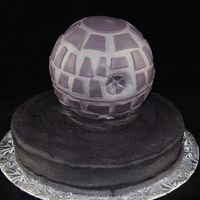 "Death Star A Death Star cake for my son's 5th birthday party. The Wilton ball pan on a 10"". It was hard getting the ball on the cake while..."