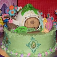 Tinkerbell And House This was my god daughter's birthday cake. She wanted Tink. I used the edible images around the cake. Teapot house was krispy treat...