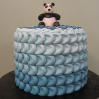 Blue Ombre Panda 2 rounds covered in buttercream using gradation effect of blues. Topped with a fondant panda.
