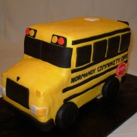 "Ncc School Bus 9"" X 13"" cake, cut in thirds, stacked & carved into a bus shape. Buttercream coat and fondant accents. Wheels are oreos..."