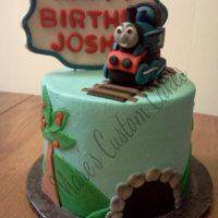 Thomas The Tank Birthday Cake Butter cream icing with fondant and gumpaste accents. Thomas is handmade.