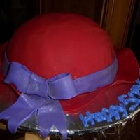 Red Hat Lady Cake this was made for a 50th birthday of a lady who was a member of the red hats, its covered in MMF and the brim and accents are MMF, thanks...