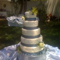 5 Tier Cornelli I was sooo happy at how straight this cake was. I got to do the flowers myself... the florist left me the leftovers to do with what I...
