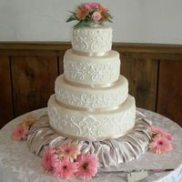 "Ivory Wedding Cake  Hello, this was my first wedding cake!!!! It is a 15""-12""-9""-6"" cake covered in ivory fondant. The scrolls were done in..."