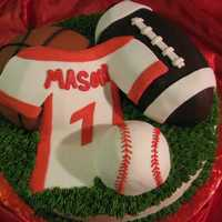 Sports Cake Football, baseball and basketball all cake covered in fondant. Jersey is fondant.