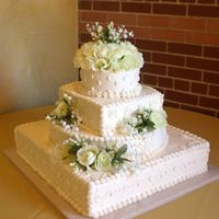 Wedding Cake. All buttercream with silk flower accents.