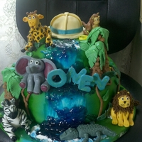 Jungle Baby Shower Cake 8inch round triple chocolate with whipped chocolate ganache filling and 12 inch round vanilla bottom. Covered in fondant and airbrushed...