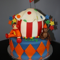 Lilly's 5Th Birthday Carnival Cake Carnival themed cake with a clown and monkey!