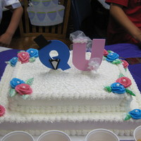 Q & U Wedding Cake  Hi! I made the Q & U Wedding cake for my son's kindergarten class. It is a white cake with lemon, chocolate and twinkie fillings....