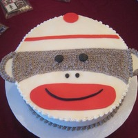 Sock Monkey Birthday  This is a sock monkey layer cake. White tie dyed cake with oreo cookie filling. Buttercream frosting and fondant accents. The sock monkey...
