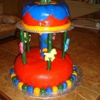 Carousel Cake Made for my niece's birthday. Fully edible, except for the dowels. The horses were made from chocolate molds.