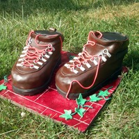 Hiking Boots I used 2 different size loaf pans and carved boot shape and covered in chocolate fondant