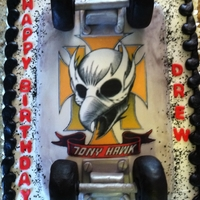Skateboard Cake buttercream with edible image on fondant covered skateboard