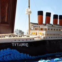 Titanic For A Sweet 16Th Birthday All the deck is made of foam covered with fondant and Tylose. The black part of the ship is the cake..serves for 300.