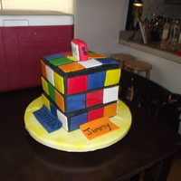 Rubik's Cube Cake! Chocolate Bourbon cake with Carmel BC covered in MMF! I love this cake was so much fun! IT MOVES!!!!!! I wished I could put the video on...