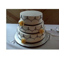 Black, White, & Yellow Wedding Simple piping with yellow sugar flowers. Inside was classic white, strawberry with cream cheese filling, and chocolate with cannoli cream...