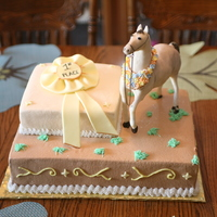 Uncles Favorite Pass Time Uncles favorite pass time. Horse is done in white chocolate and rice krispiescake is buttercream, and ribbon is fondant