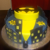 Batman Birthday Cake Bottom layer is covered in buttercream with fondant accents, top layer is covered in yellow fondant.