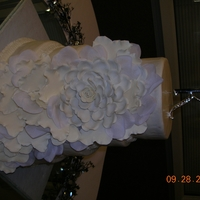 White Wedding Cake all buttercream icing with gum paste roses and rose petals.
