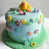 "Easter Chick Fondant covered cake with modeling paste figure and flowers.The cake is only 8"" long and 8"" height. This will be a present to my..."