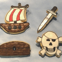 Pirate Cookies   Rolled sugar cookies covered in Rolled Buttercream with RI details. Made for my nephew who doesn't like cake
