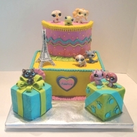 Littlest Pet Shop Present Cake My daughter's birthday cake. She had a coloring page she liked that was the inspiration, but we added different aspects. Plus she...