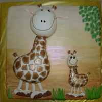 Mama And Baby Giraffe  Baby shower cake (gender of baby unknown) inspired by a cake in a Lindy Smith book. Base cake vanilla, mama giraffe chocolate cake. All...
