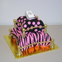 A Chanel Birthday  This cake is for my niece who turned 13. She loves Chanel and zebra print. Vanilla cake covered in fondant. We used the Wilton pillow pans...