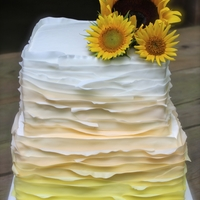 Sunflower Ombre Ruffle   Bride chose Maggie Austin inspired ruffle cake for her big day.TFL!
