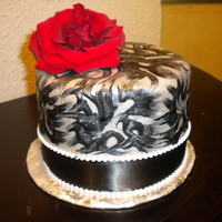 Black Swirl Cake black and white swirled icing over fondant with a red rose