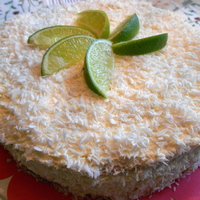 Coconut, Lime & Passionfruit This cake is filled w/ lime and passionfruit, and covered w/ whipped cream and coconut. TFL!