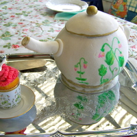 Teapot Cake For Mother's Day Earl Grey cake with raspberry buttercream for my mother. The cup is not edible. I got a lot of inspiration for the cake her on CC. TFL!