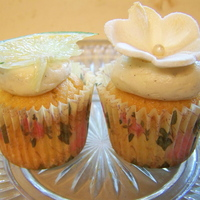 Lime Cupcake Mini lime cupcake with passionfruit frosting, decorated with lime/marzipan flower. TFL!