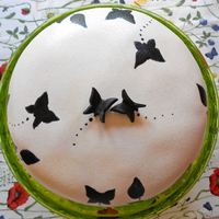Black And White Butterfly Cake A small cake for a pair of good friends of mine. Filled with strawberries and peaches, and covered with whipped cream and marzipan....