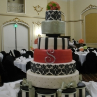 "Damask And Stripes This was one gigantic cake. 30"" base, 9 x 6"" rounds, 18 and 21"" dummies, 9, 12, 15"" cakes, 6"" dummy. Hand painted..."