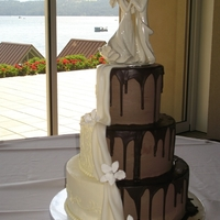 Half And Half Combo Bride and groom combo cake, IMBC with ganache and MMF draping, GP flowers. Fun design and not as hard as I thought, to do