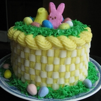 Easter Basket Cake Pastel striped cake with Buttercream and candy decorations
